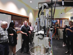 Jcanna Boot Camp attendees touring an extraction setup